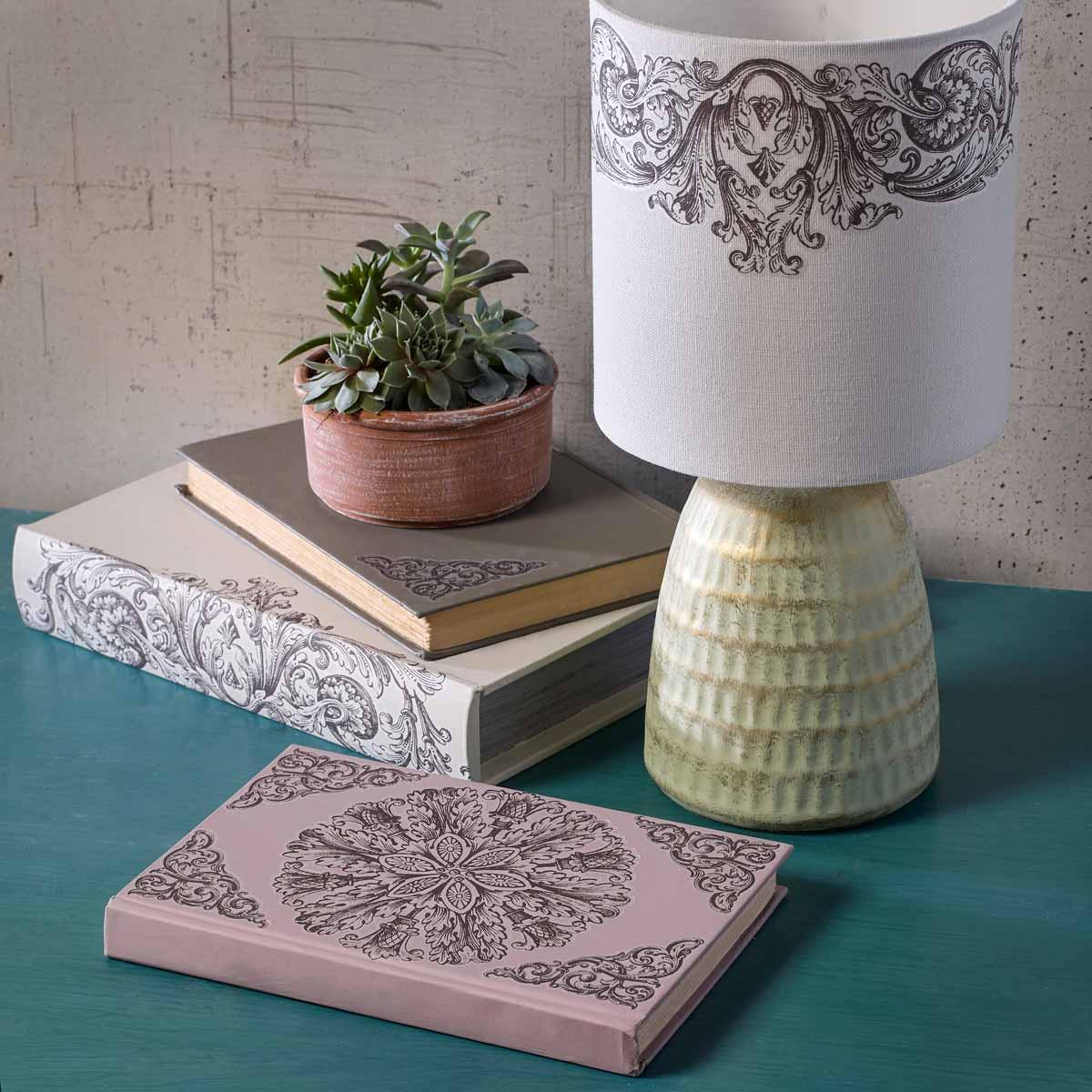 Ornate Lamp, Books, and Garden Pot