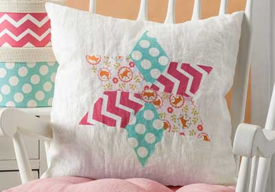 Faux Quilted Nursery Pillow with Fabric Mod Podge