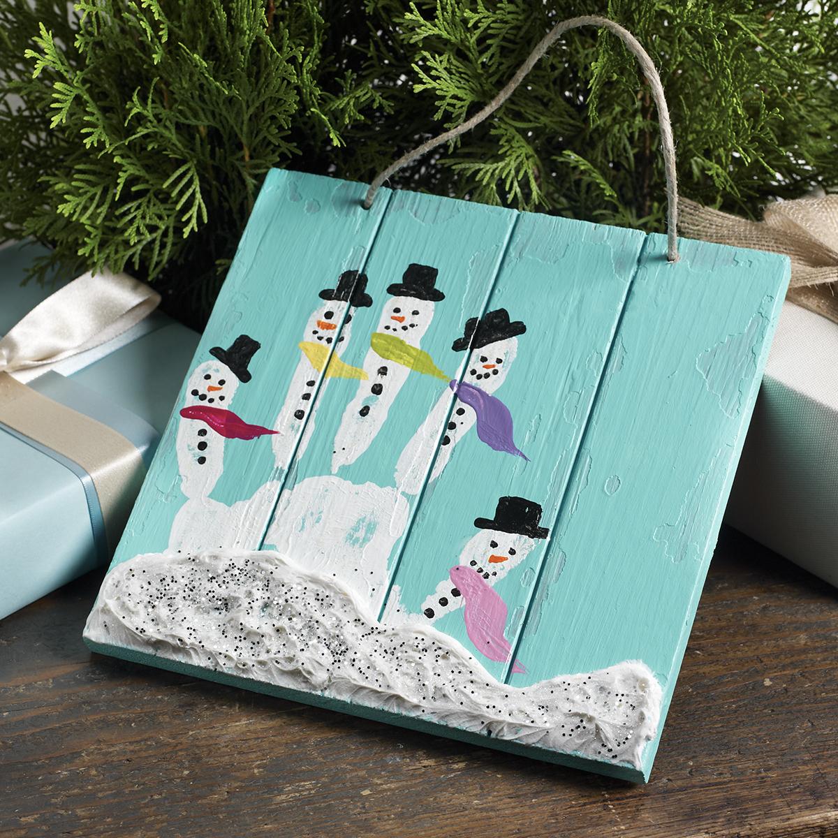 Painted Handprint Snowmen Family